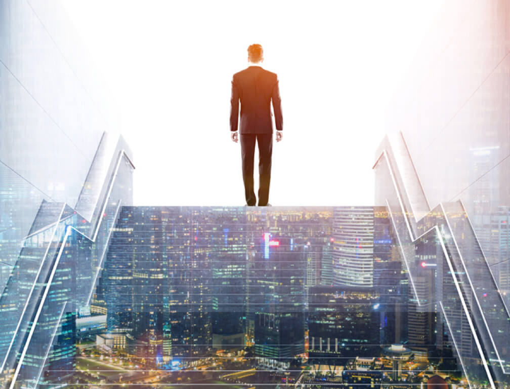 man in a suit is standing on top of a transparent staircase of the city