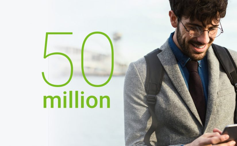 oung entrepreneur looks at the phone screen and smiles, Share4you 50 million opened account