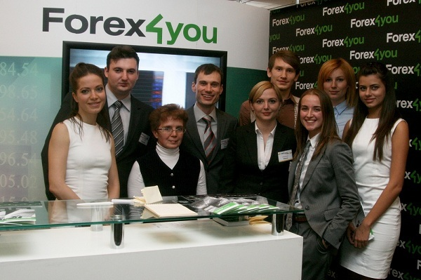 Forex4you representatives standing next to company's stand at Moscow expo in 2011
